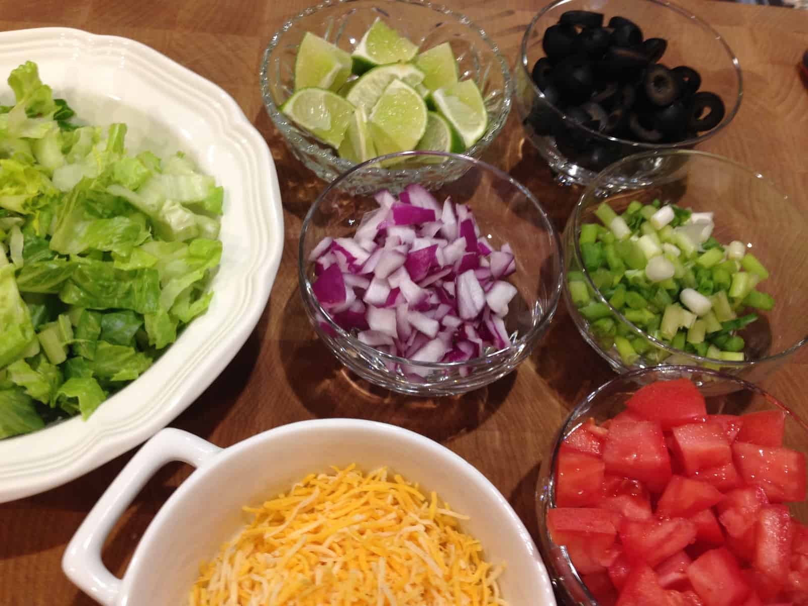 assorted bowls with taco salad toppings