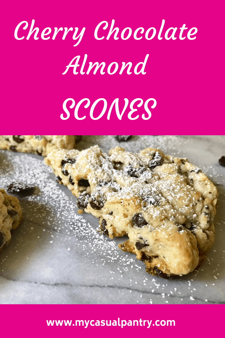 cherry chocolate almond scones with a dusting of powdered sugar