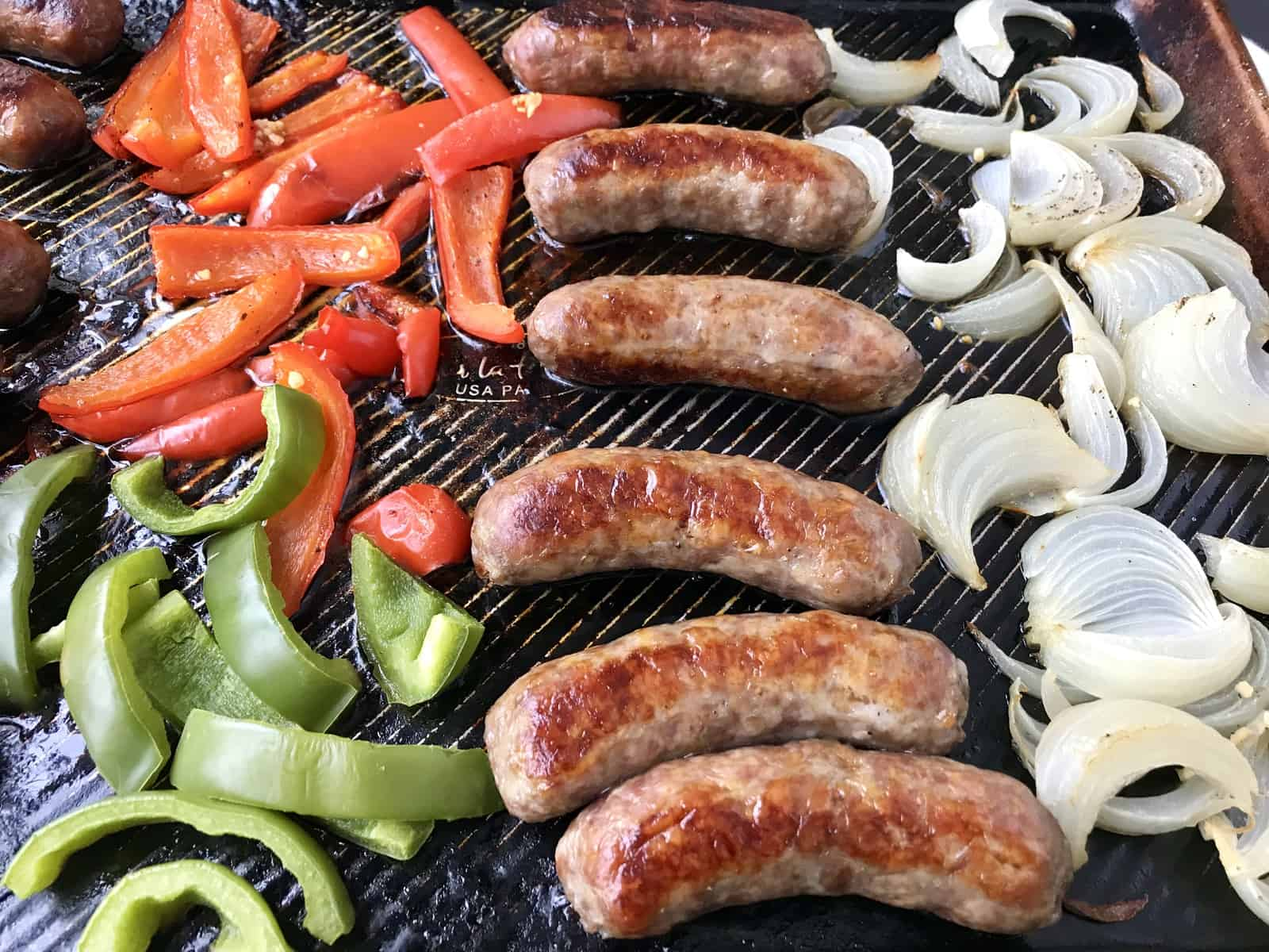 Sheet pan of sausage, peppers, and onions
