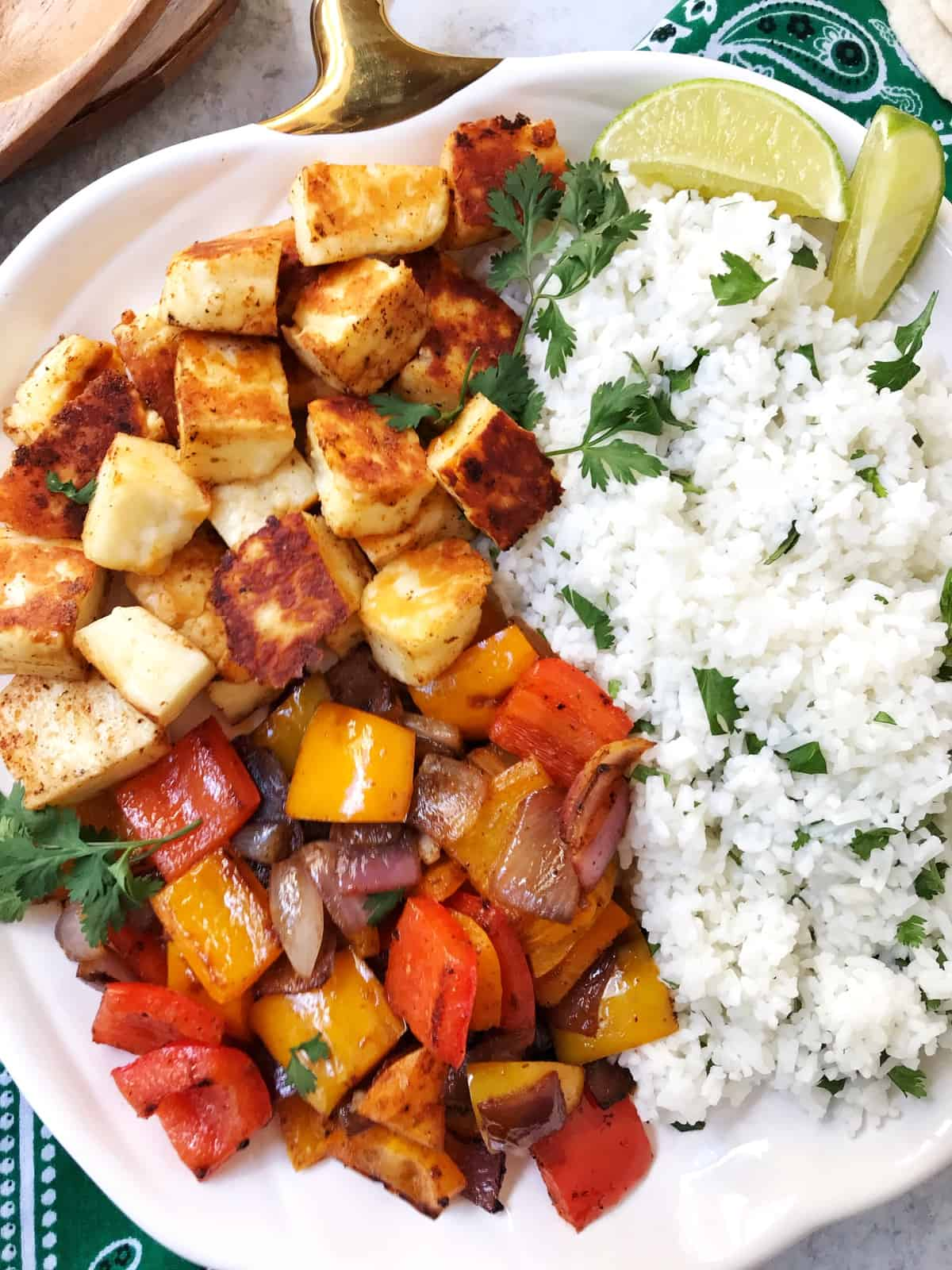 plate of fried halloumi with peppers, onions, and rice