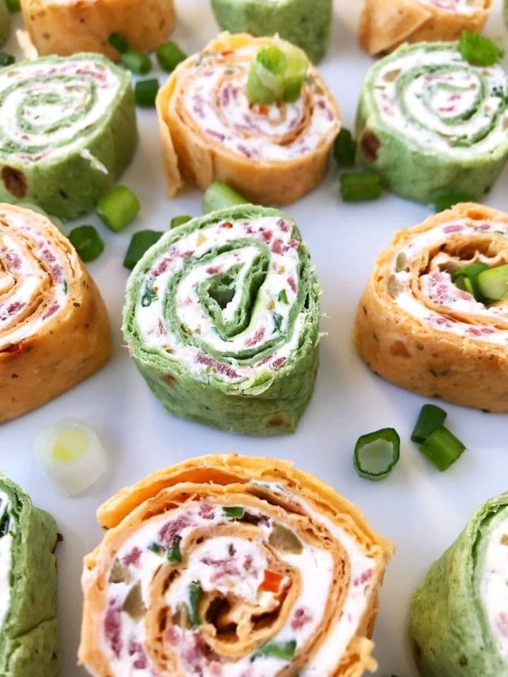 roll-ups on a plate garnished with scallions