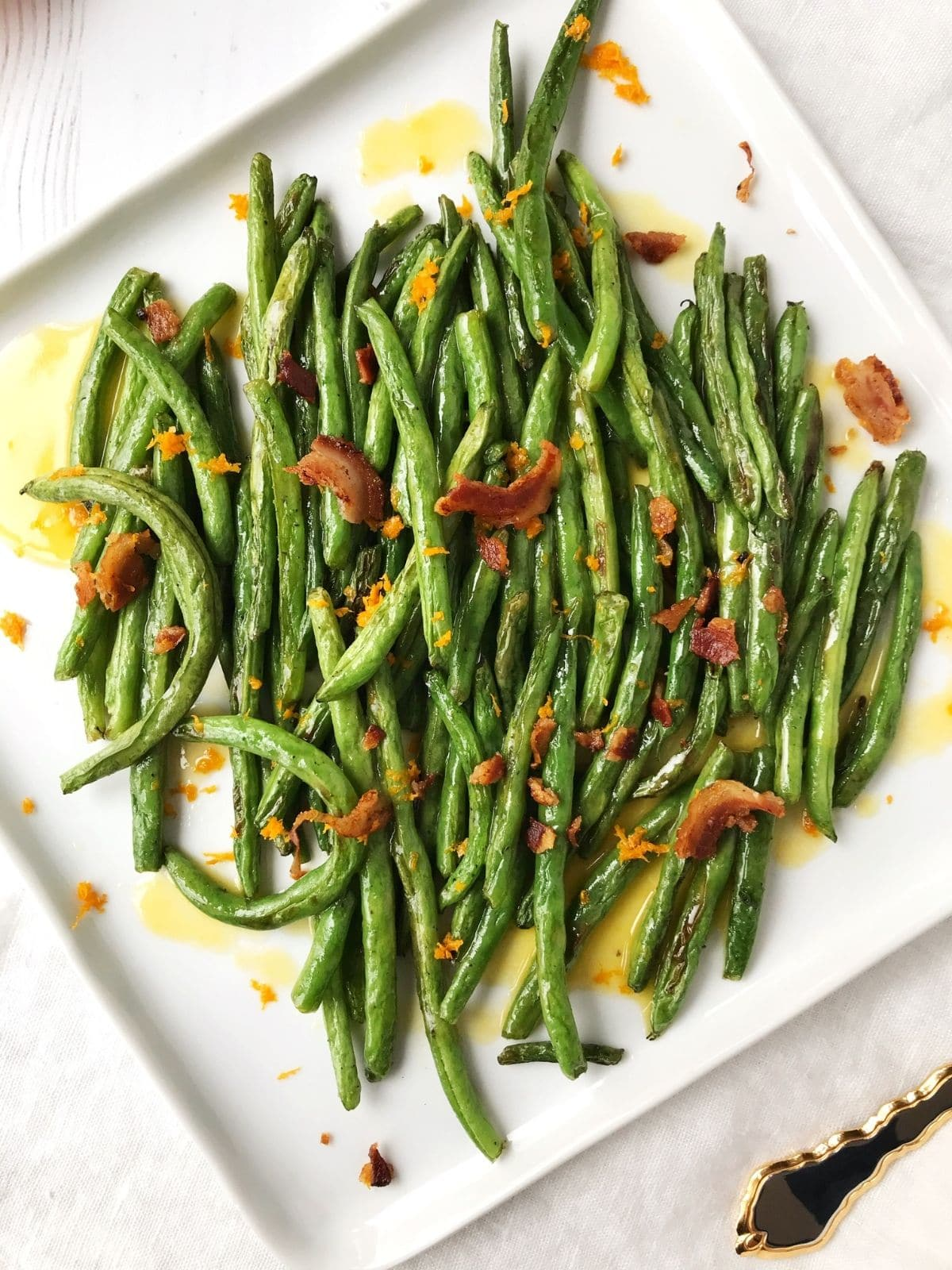white serving plate with beans