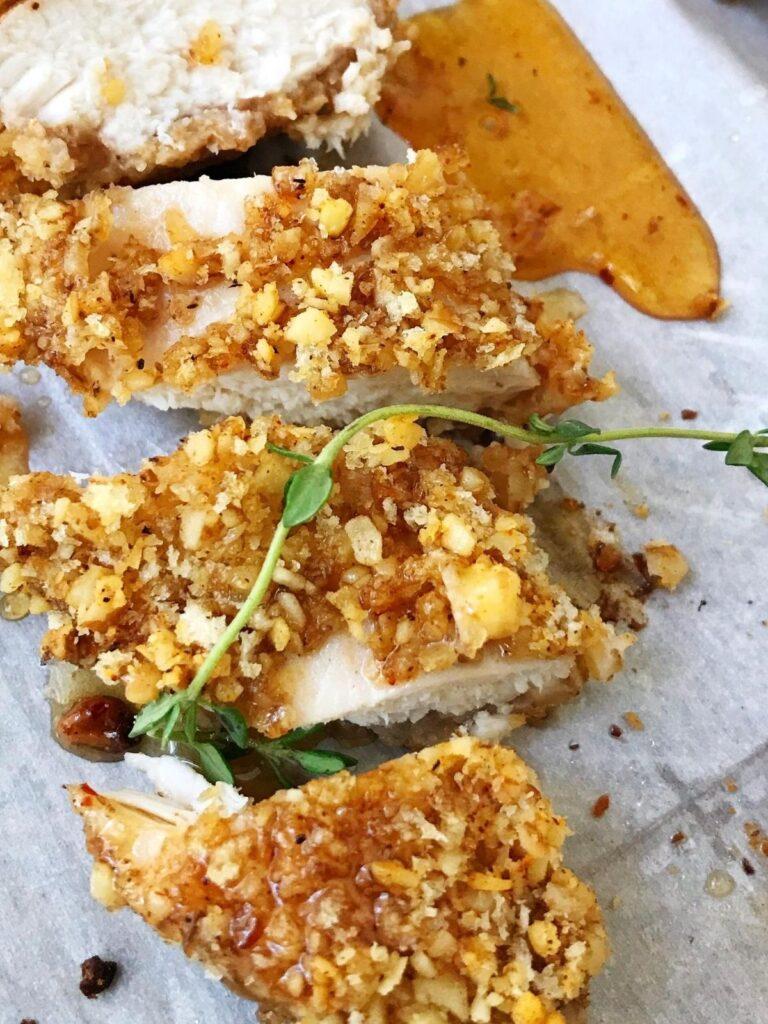close up of sliced walnut chicken with honey