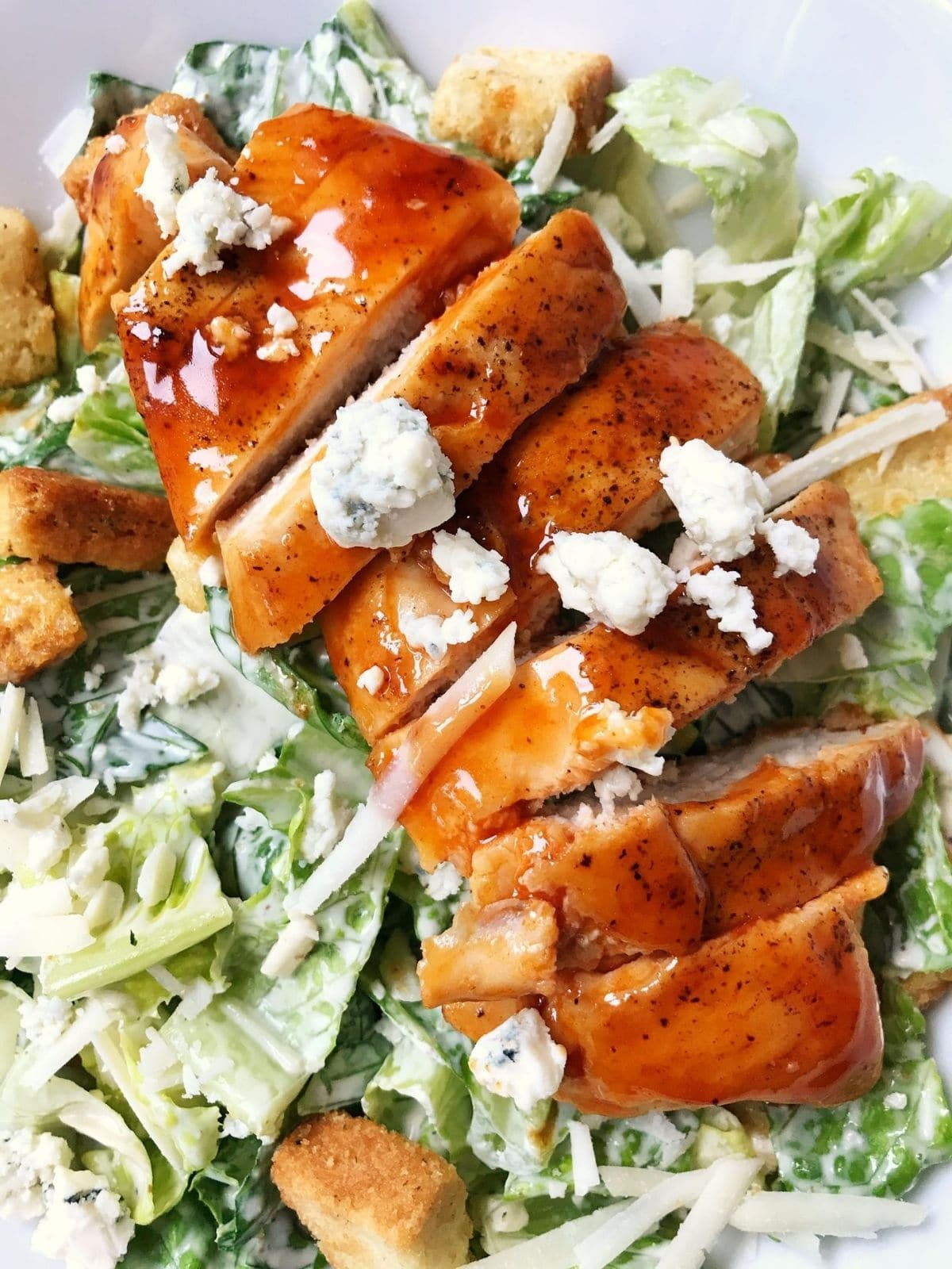close up of chicken on top of lettuce