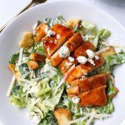 sliced chicken on top of salad