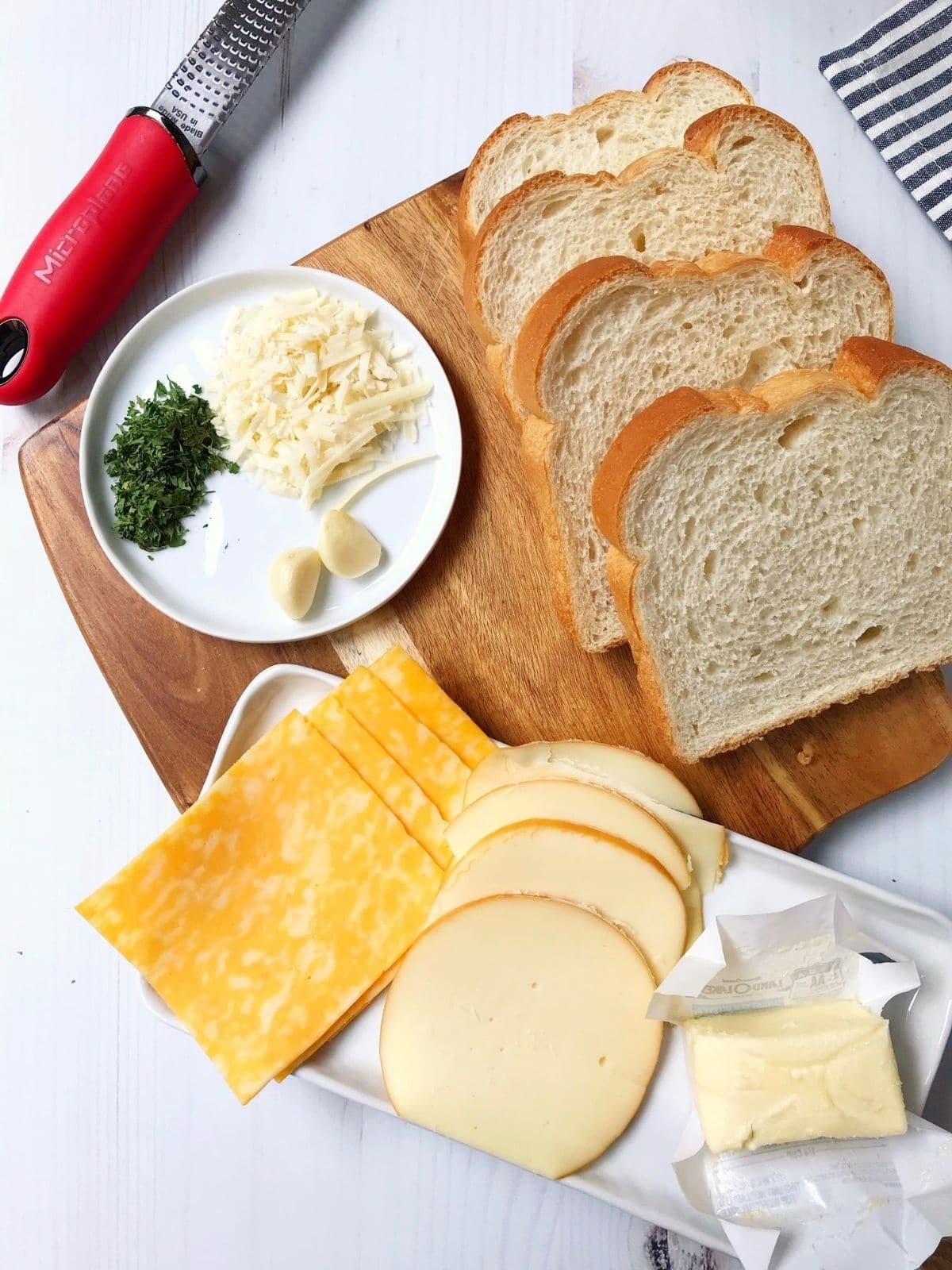 butter and sandwich ingredients on a board