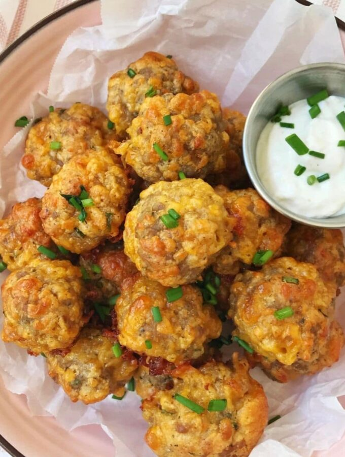 bowl of sausage balls with dipping sauce
