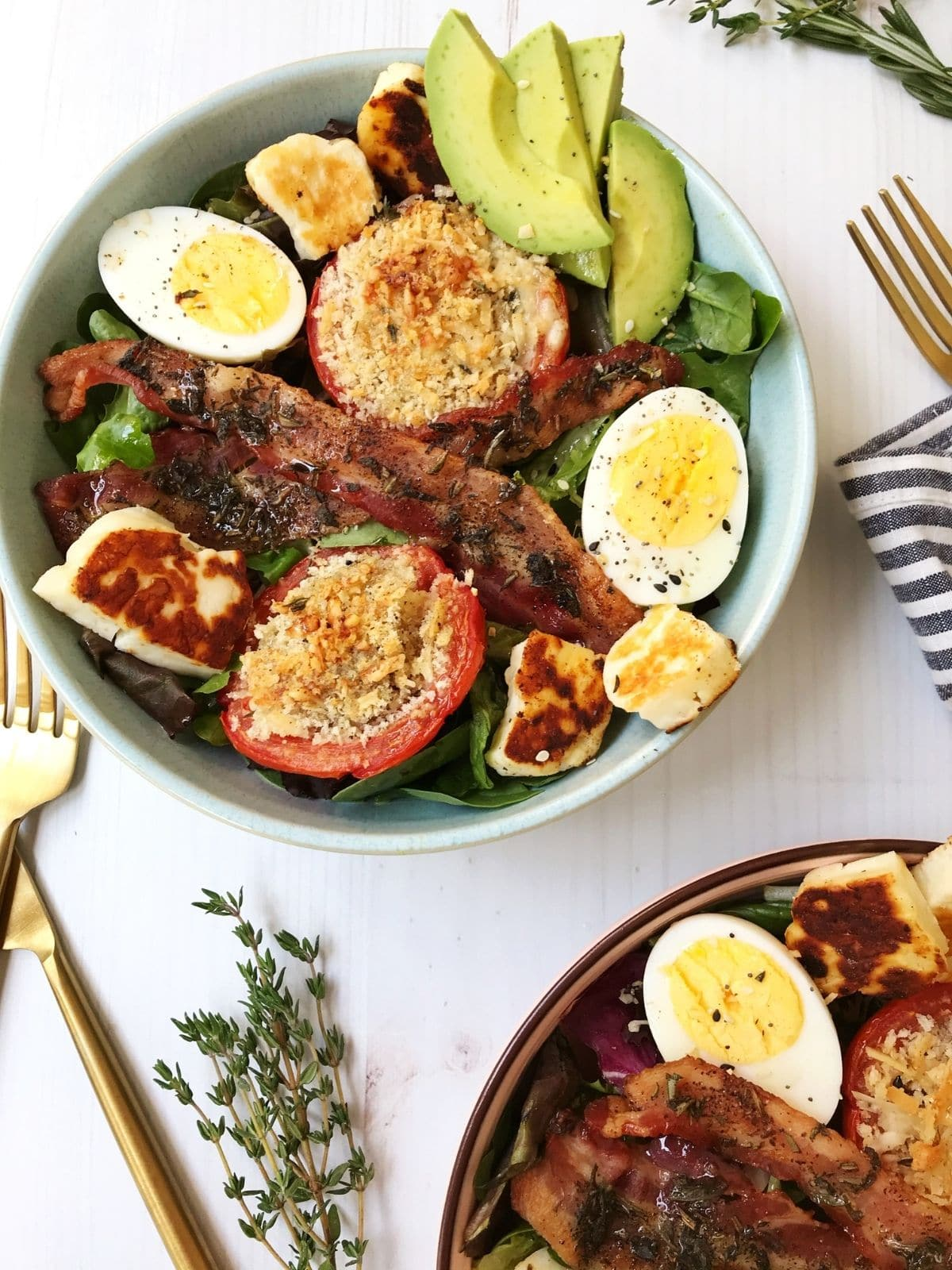 two bowls of breakfast salad with forks