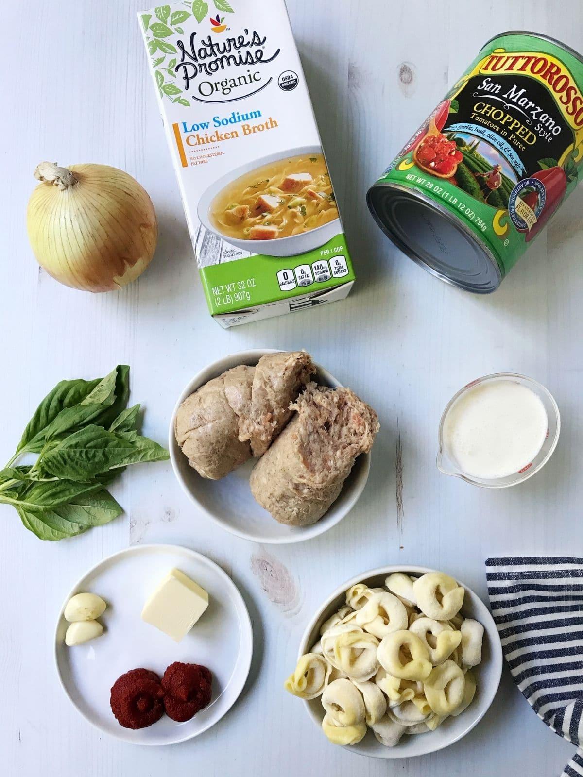 ingredients-sausage, tomatoes, broth, tortellini, cream, seasonings