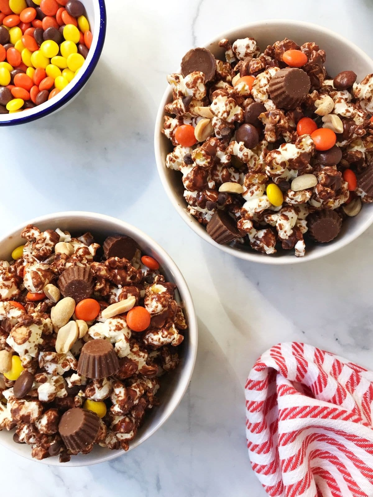 two bowls of popcorn with extra reese's pieces