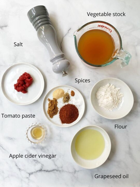 small bowls of broth, spices, flour, oil, tomato paste, vinegar