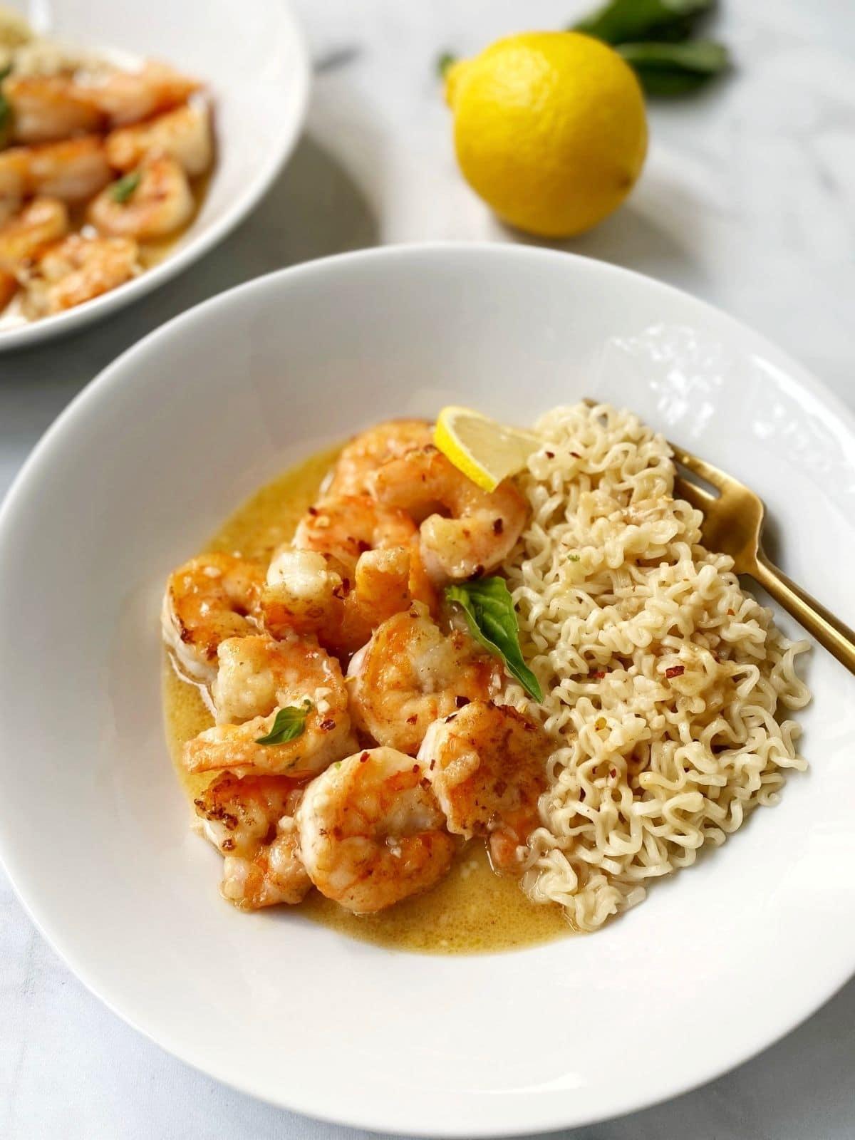 fork in a bowl of lemon butter shrimp