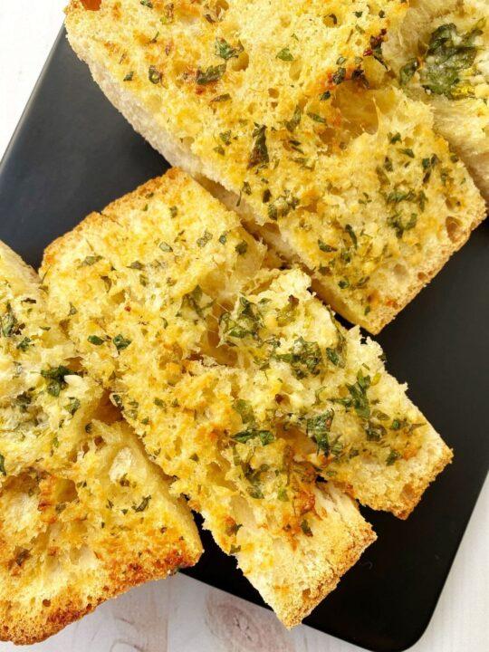 close up of slice of garlic bread
