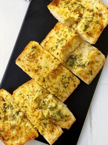 slices of garlic bread on a board