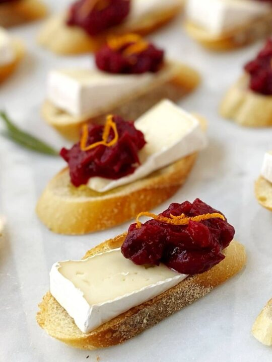 toasts topped with brie and cranberry