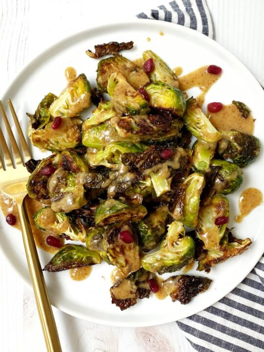 plate of roasted sprouts with a fork