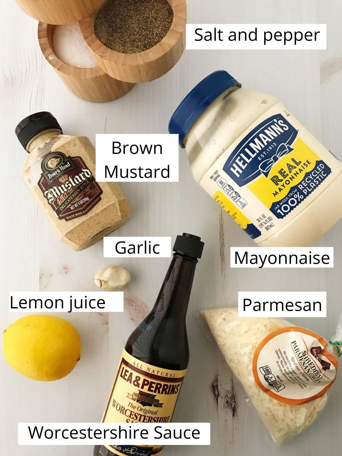 Caesar dressing ingredients - mayonnaise, mustard, garlic, lemon, parmesan, Worcestershire