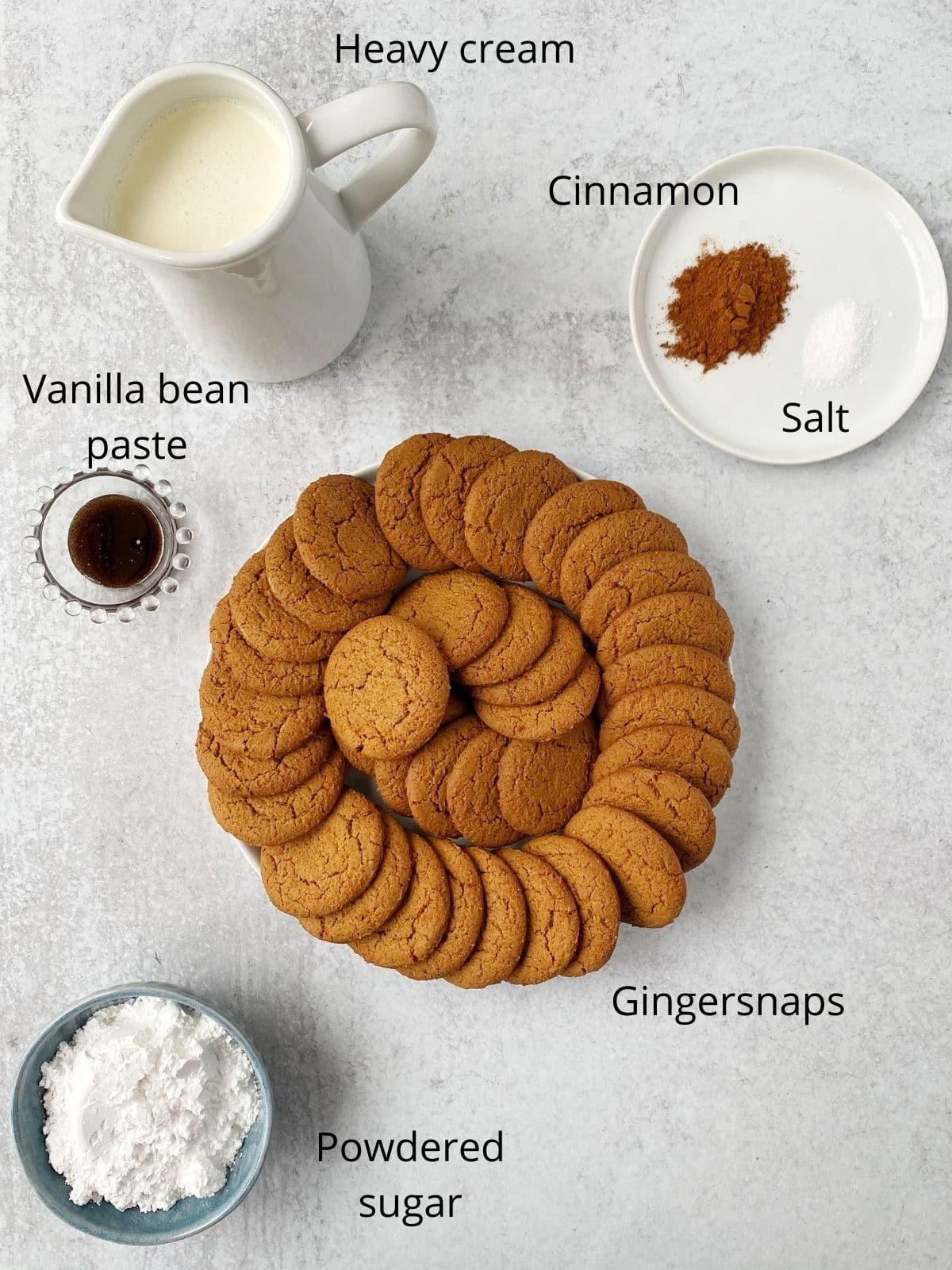ingredients in cake - gingersnaps, whipping cream, vanilla, cinnamon, powdered sugar, and salt