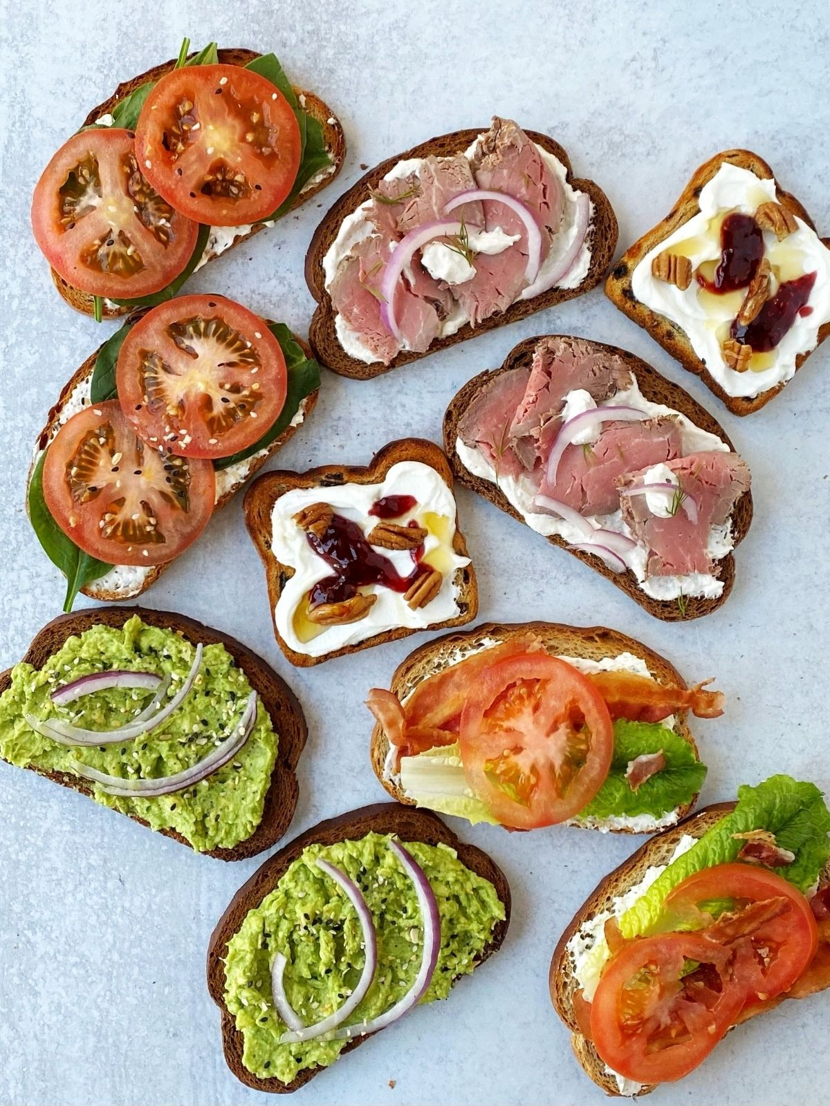 five different types of toast with various toppings
