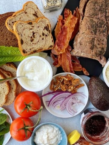 toast brunch ingredients-breads, bacon, beef, onion, tomato, spinach, preserves, nuts, honey, yogurt, cream cheese, avocado