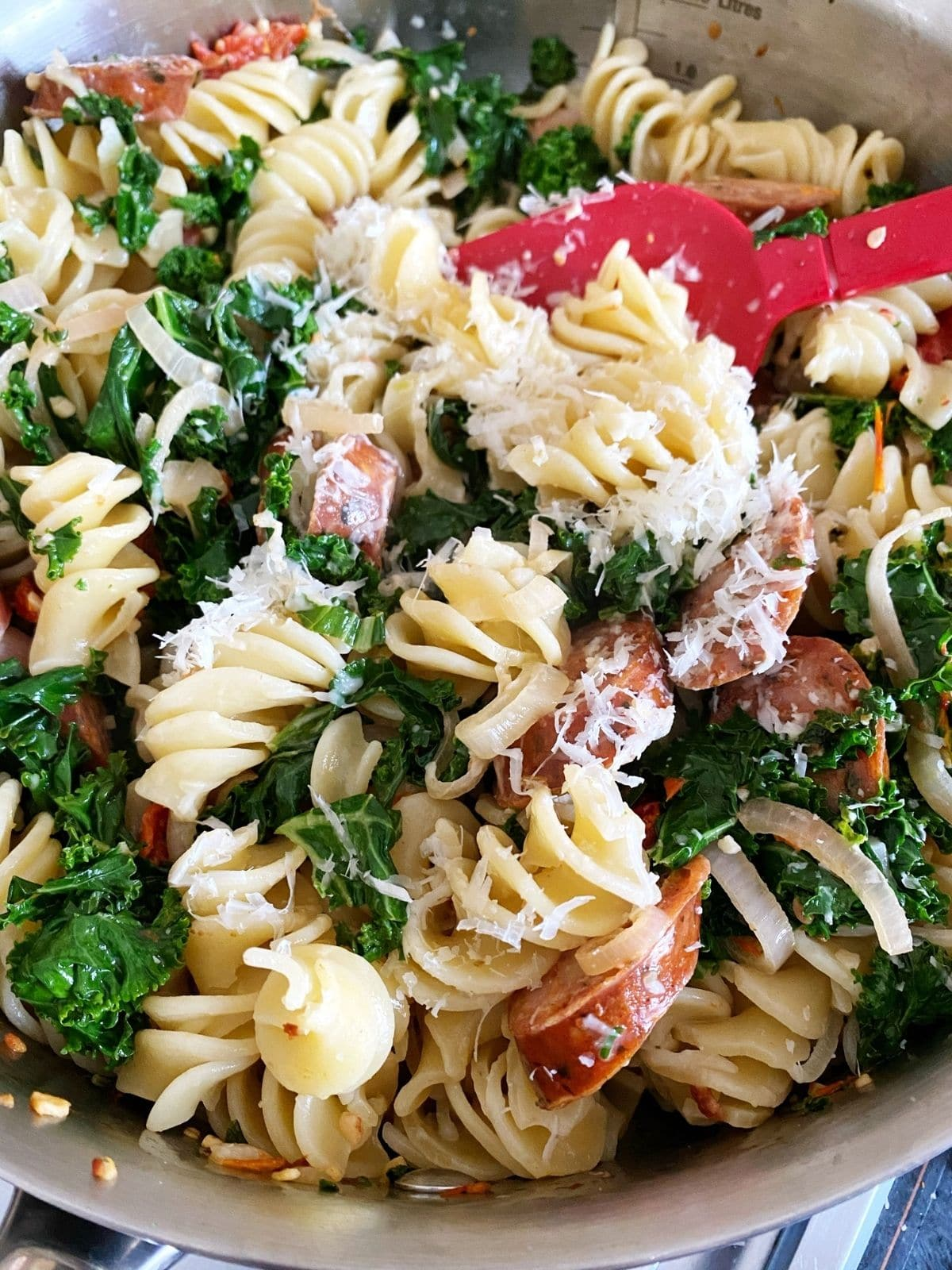 skillet of pasta with parmesan sprinkle on top