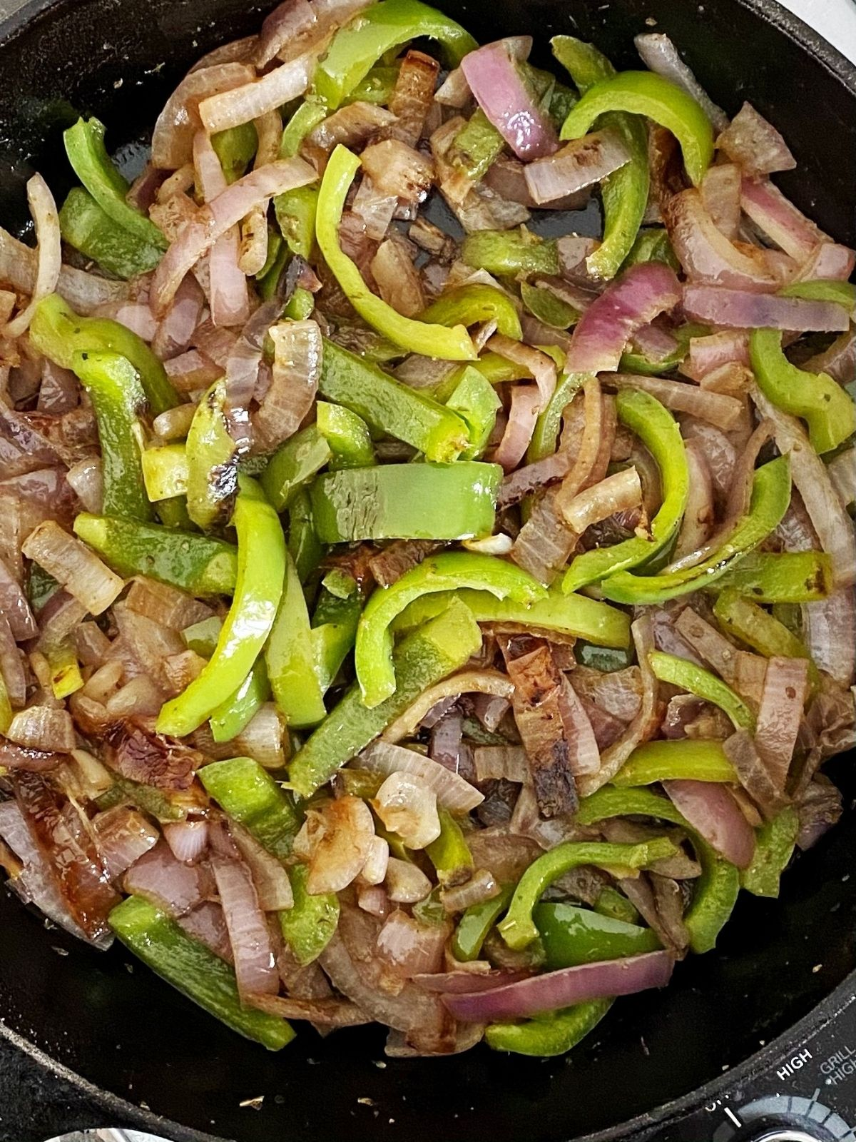skillet of charred peppers and onions
