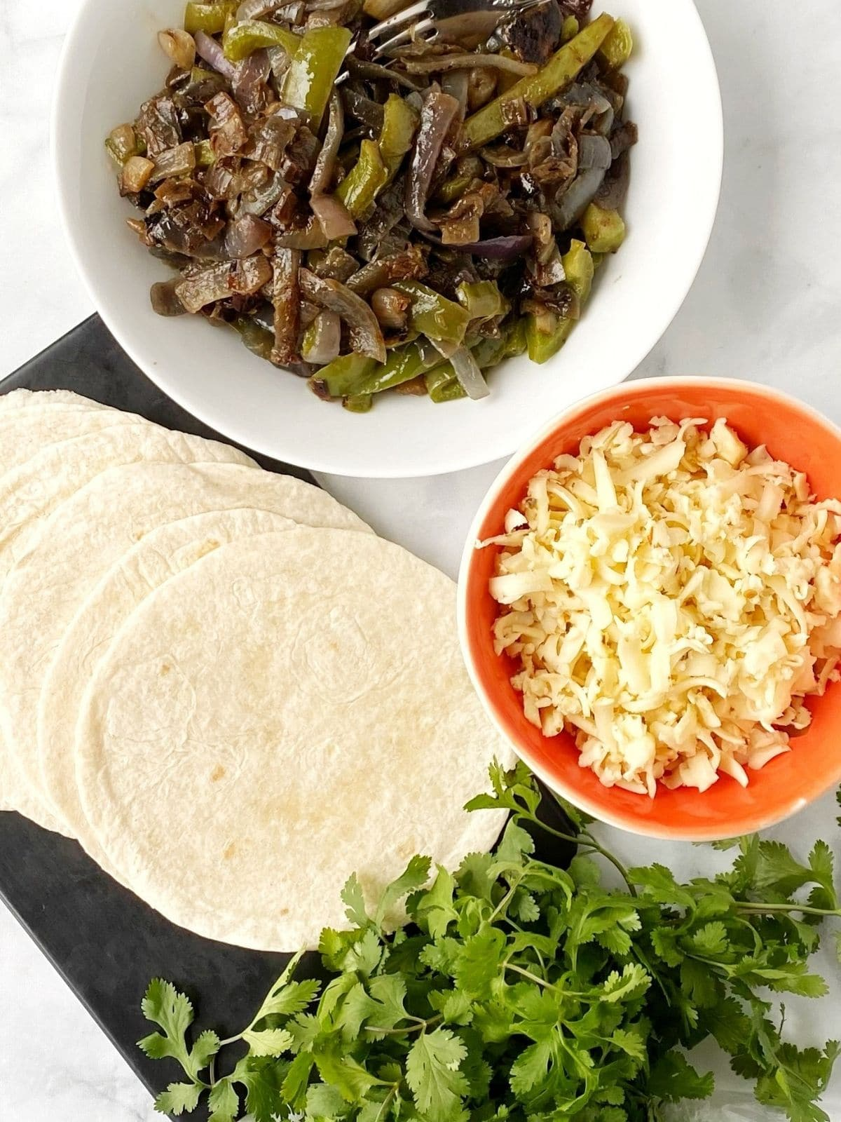 tortillas, cheese, and fajita veggies