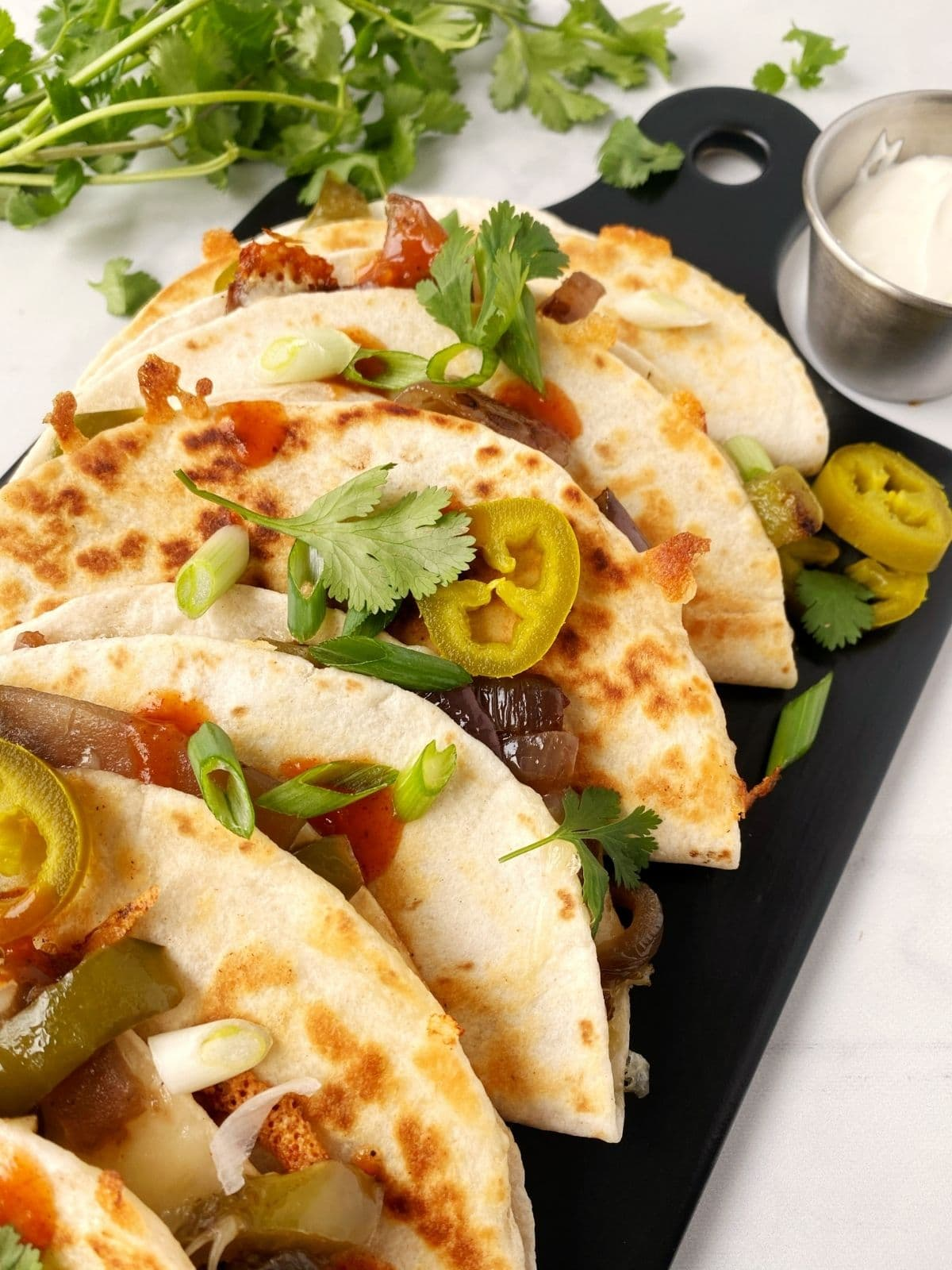 serving board of stacked quesadillas