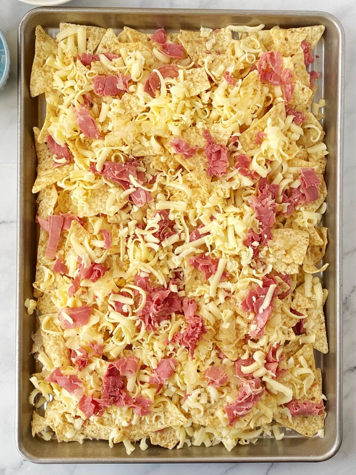 chips layered with corned beef, cheese, and sauerkraut