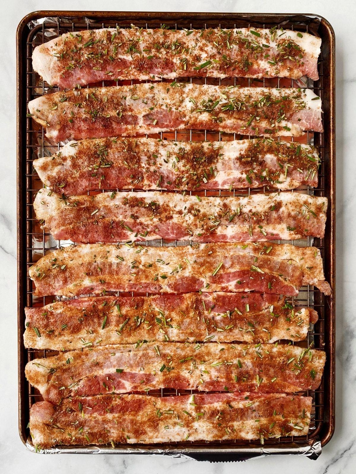 seasoned bacon on baking sheet
