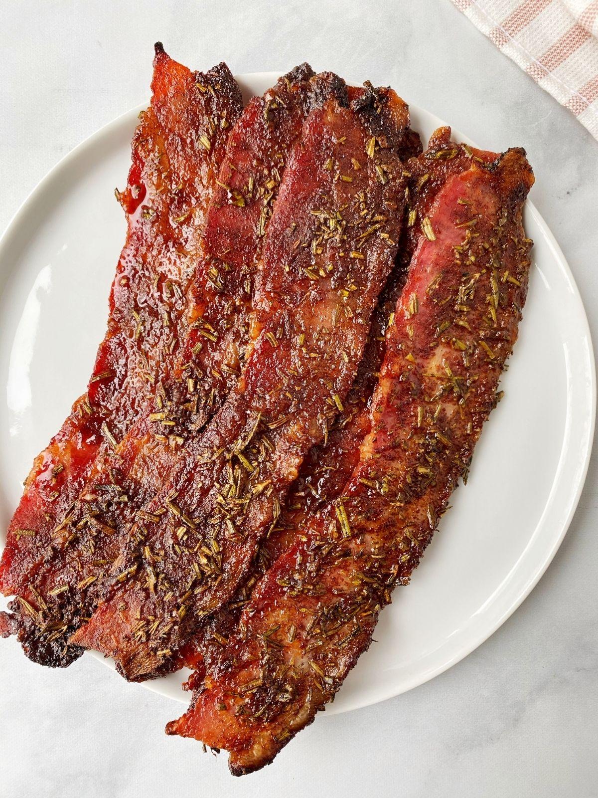 seasoned bacon piled on a white plate