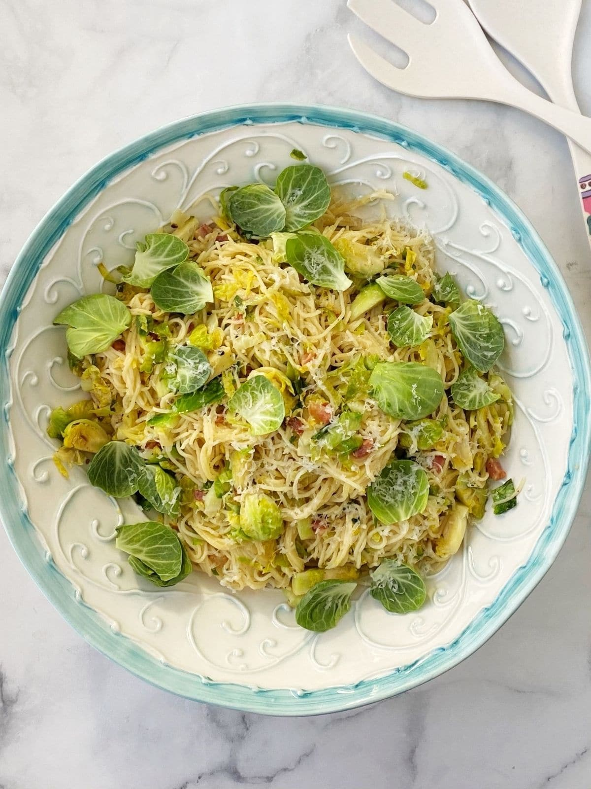 serving bowl of pasta, Brussels, and pancetta