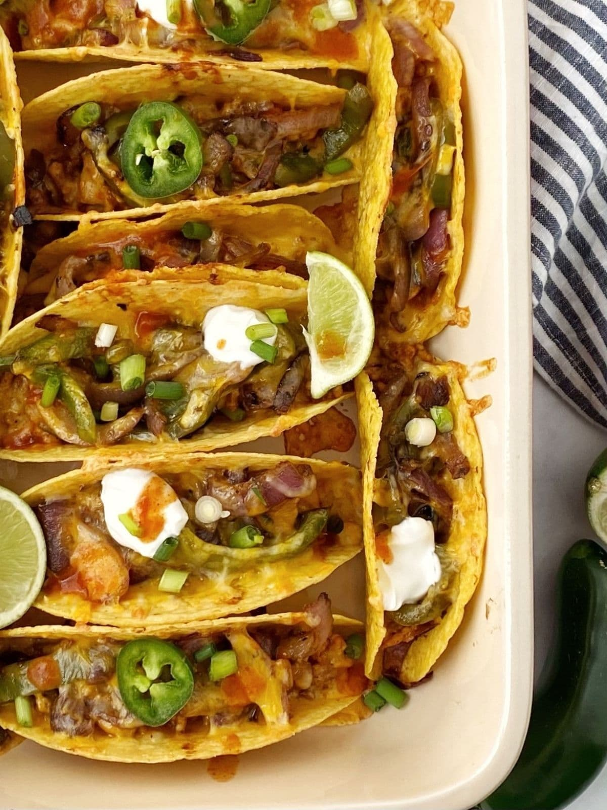 close up of tacos in baking dish