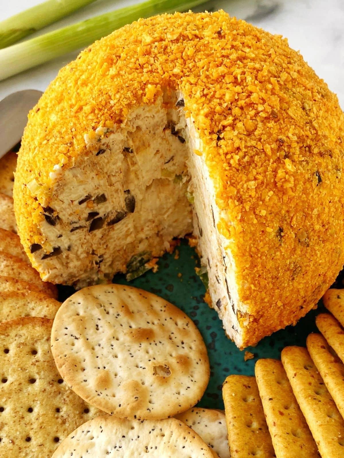 cheeseball with a cut wedge