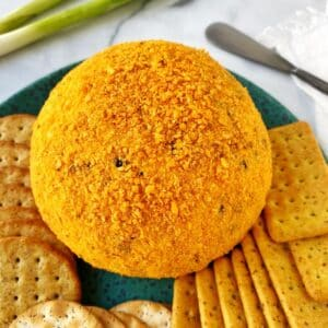 cheese ball on a platter with crackers
