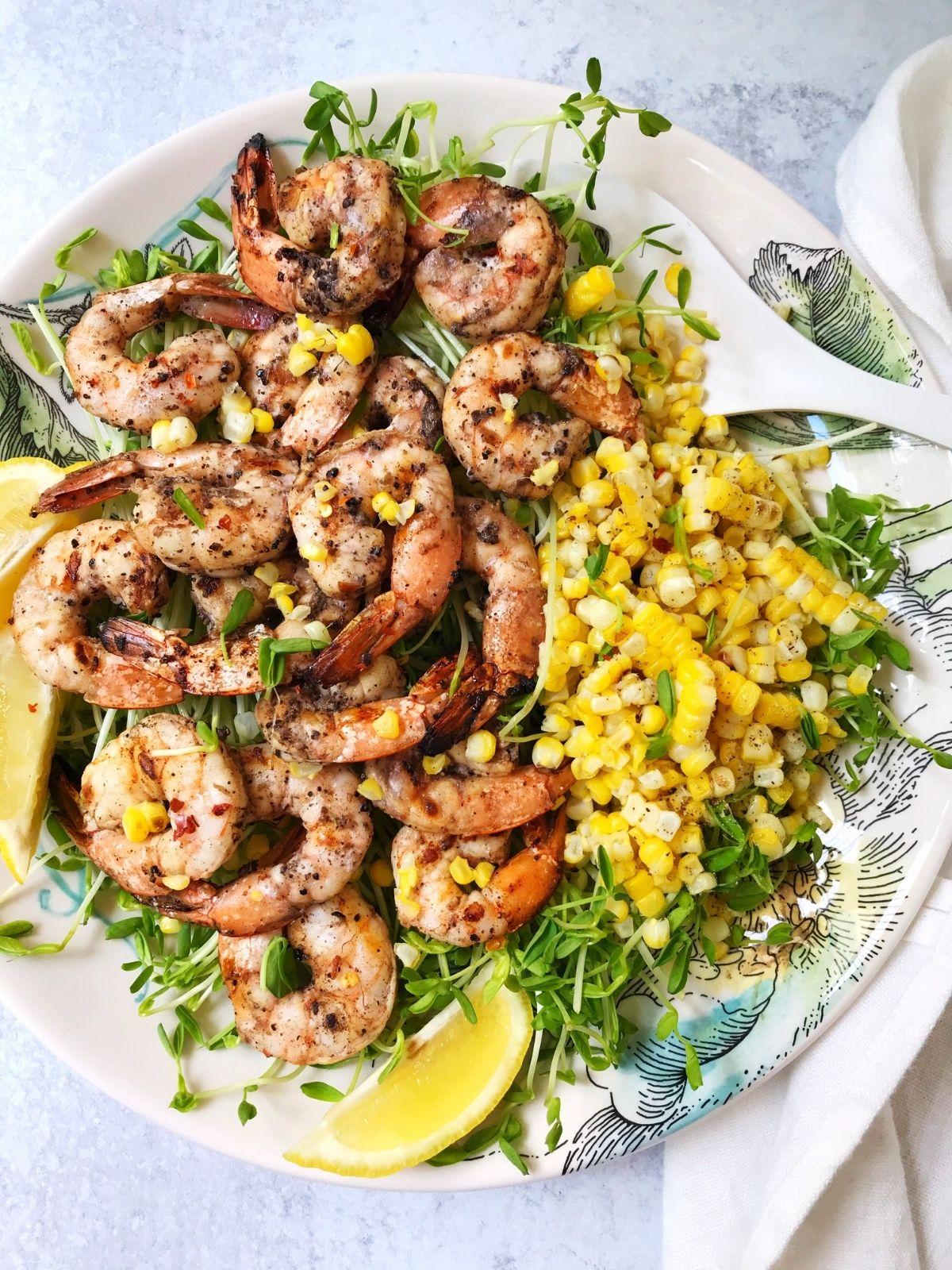 platter of shrimp and corn