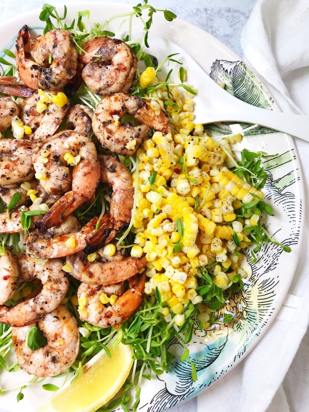 platter of shrimp with corn on the side