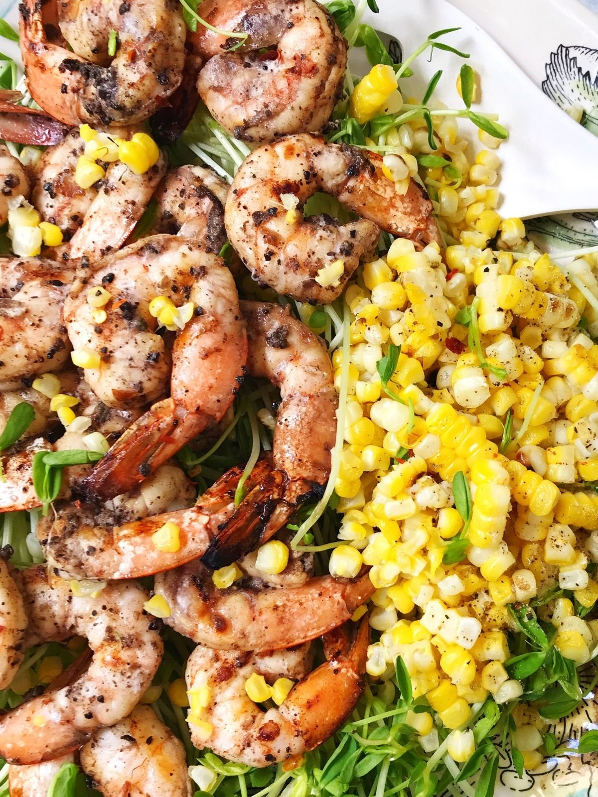 close up of grilled corn with shrimp