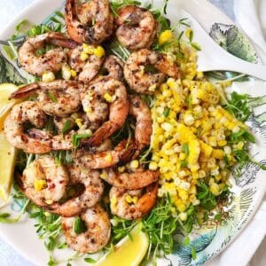 shrimp with grilled corn on a serving plate