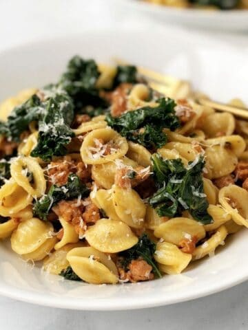 bowl of pasta with sausage and kale
