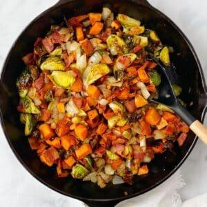 serving spoon in skillet of hash