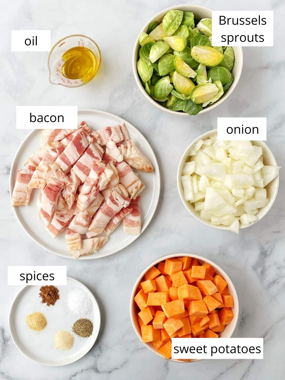 ingredients - Brussels, potato, onion, bacon, spices, and oil