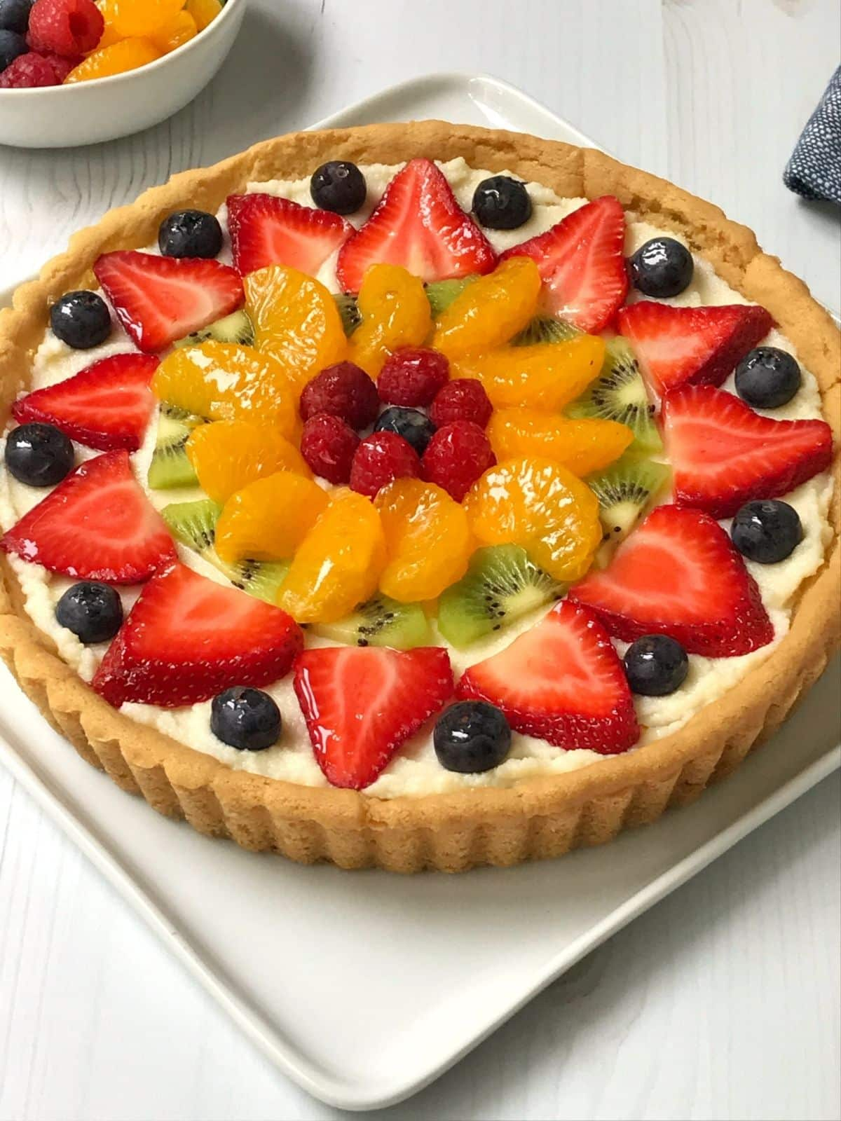 angled view of whole fruit pizza