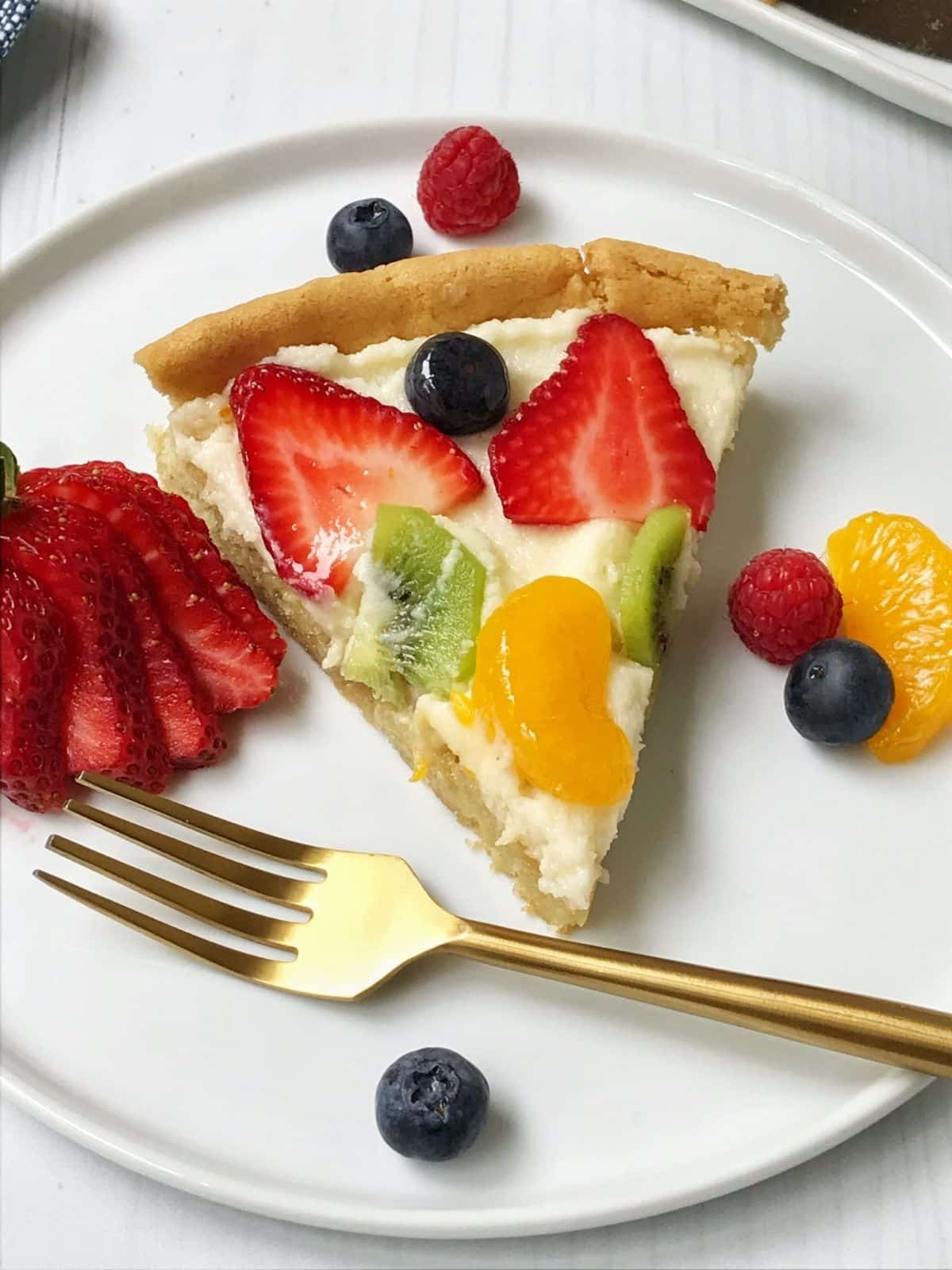 slice of fruit pizza on a plate
