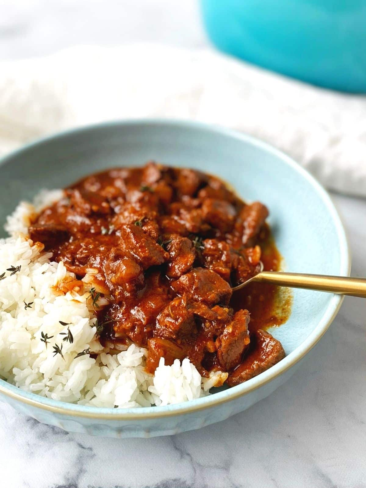 bowl of stew over rice