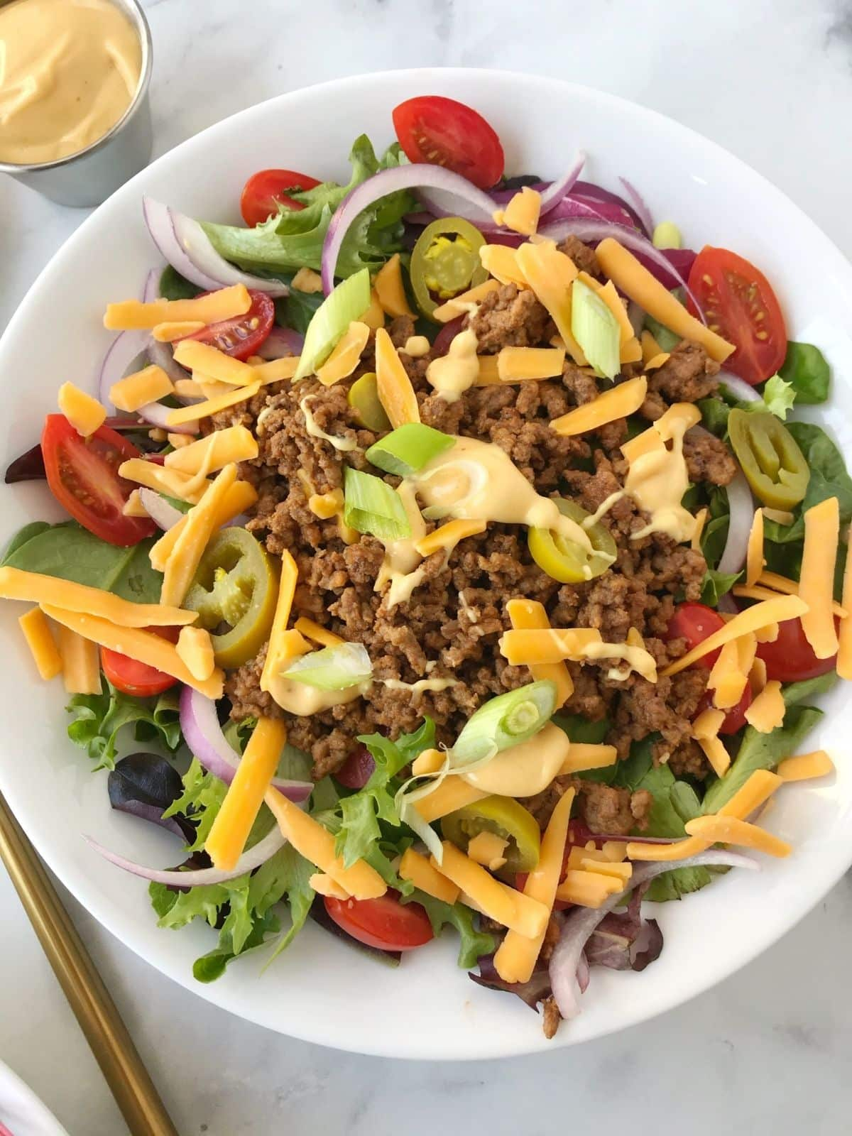 bowl of salad with toppings