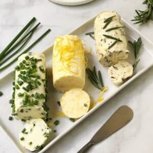 three butters arranged on a serving platter with spreader