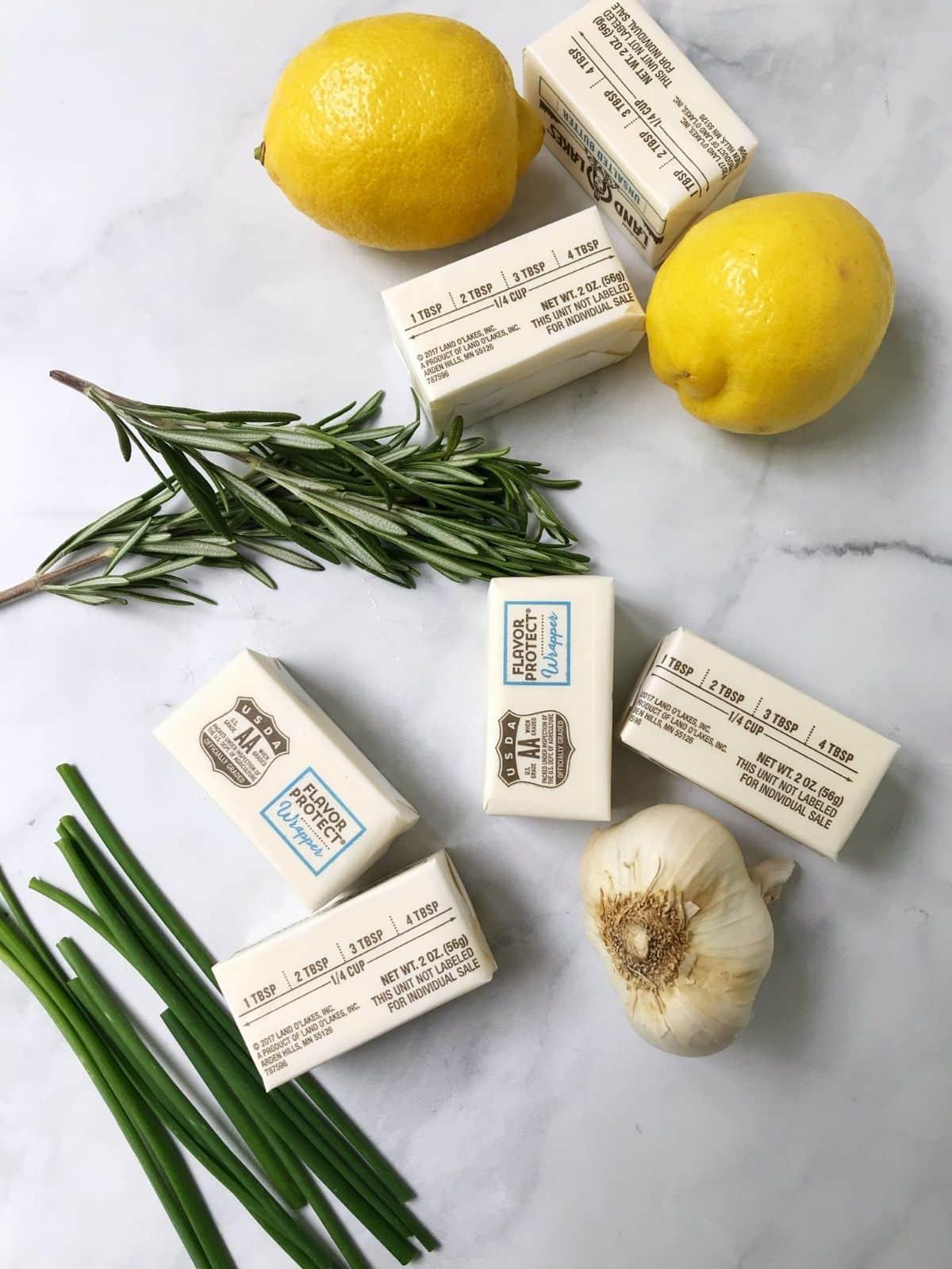 ingredients - butter, lemons, rosemary, garlic, chives