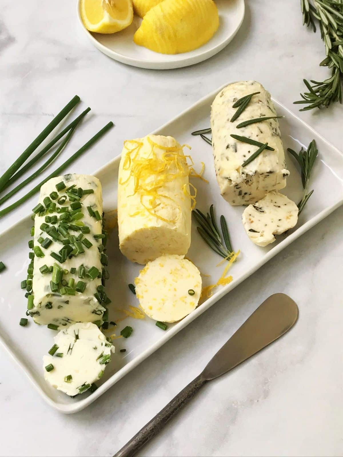 butter on a serving platter with spreadeer