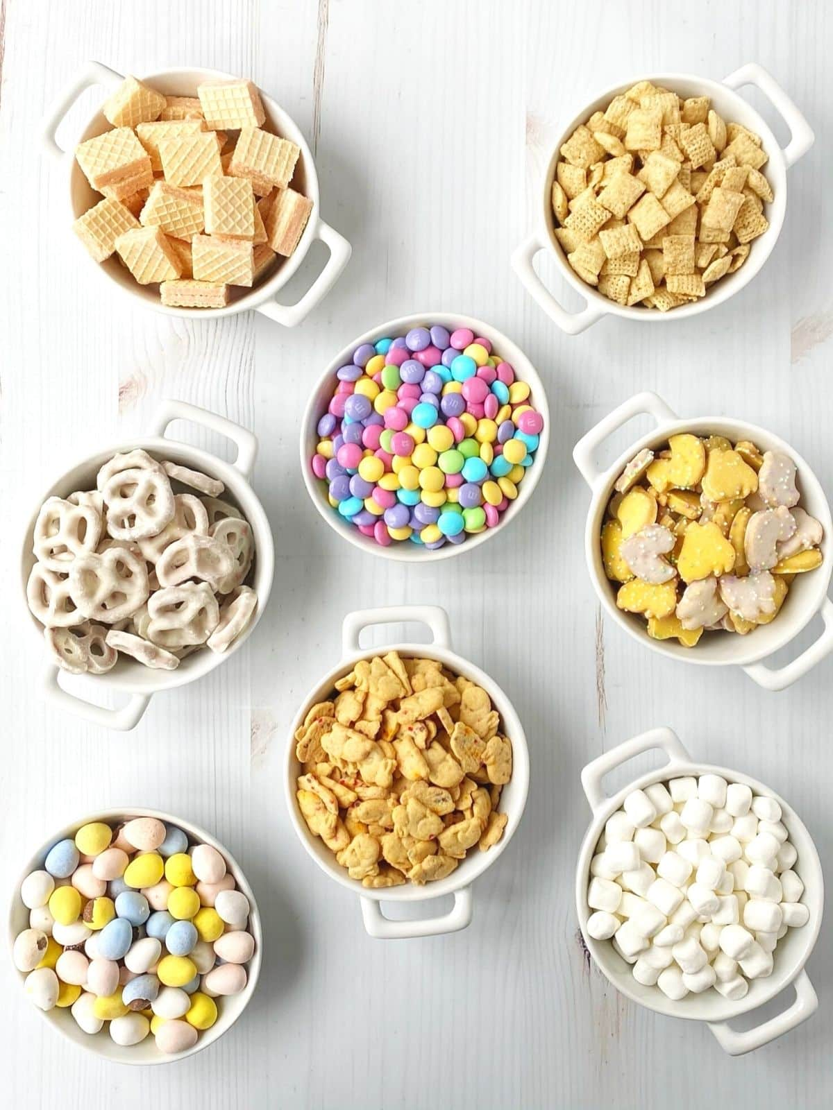 bowls of ingredients - chocolates, cereal, pretzels, grahams, cookies, and marshmallows